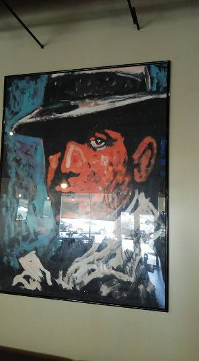 Italian Gangster Art on the wall at Coco Pazzo